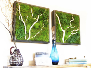 Wall hangings with white birchwood accents in a reclaimed wood frame.